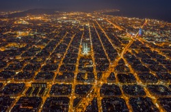 Aerial night view of Barcelona Eixample residencial district and famous basilica, Catalonia, Spain