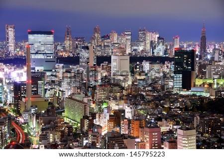Aerial night view over Ebisu, Tokyo, Japan looking towards the skyscraper district of Shinjuku.