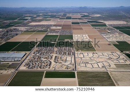 Aerial of a patchwork of farmland and homes in Arizona