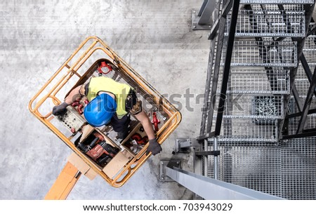 aerial of a worker with blue...