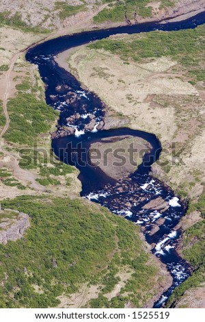 Aerial of an Icelandic landscape showing river