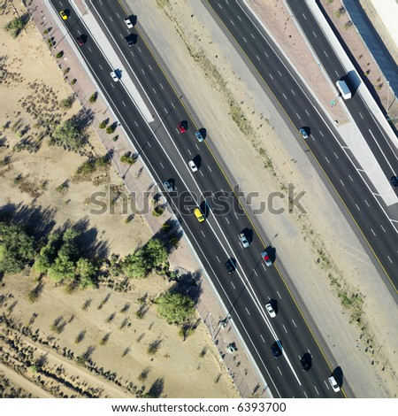 Aerial of Arizona highway with automobiles.