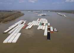 Aerial of barge tow approaching a bend in the Mississippi River