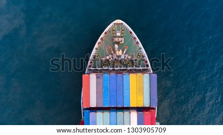 Aerial of cargo ship carrying container and running for export  goods  from  cargo yard port to other ocean concept freight shipping ship on blue sea, logistic service and transportation.