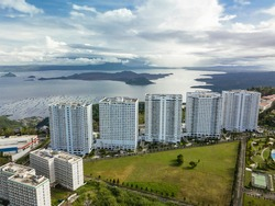 Aerial of condominium buildings overlooking the Taal Caldera. Highrise apartments in Tagaytay, Cavite, Philippines