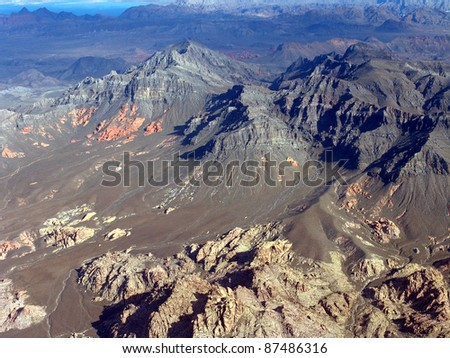 Aerial of desolate desert mountains.