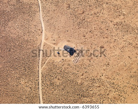 Aerial of house in remote area of Arizona desert.