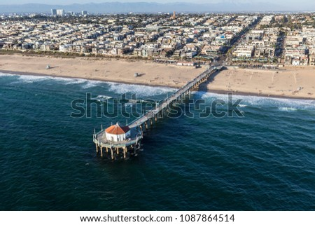 Aerial of Manhattan Beach Pier and the pacific ocean near Los Angeles California.   #1087864514