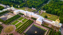 Aerial of Peterhof Castle, with the gardens and water fountains with the water canals behind it