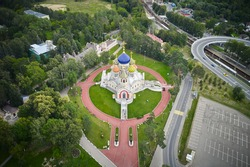 Aerial of Russian Orthodox church with colored cupola and gold religious crosses