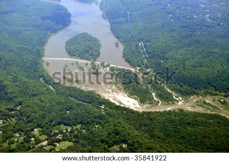 Aerial of the Great Falls National Park on the Potomac River near Washington DC. Below is Great Falls, Virginia, and behind the river is Potomac, Maryland. - stock photo