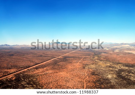 Aerial of the U.S. Mexico border fence in the Arizona desert