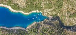 Aerial overhead drone shot of Stiniva covert cove beach in Adriatic sea on Vis Island in Croatia in summer