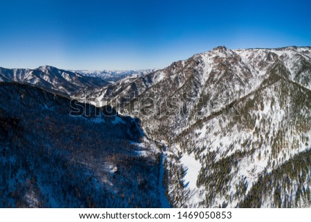 Aerial pano of winter mountain, Altay region. Landscape photo captured with drone. #1469050853