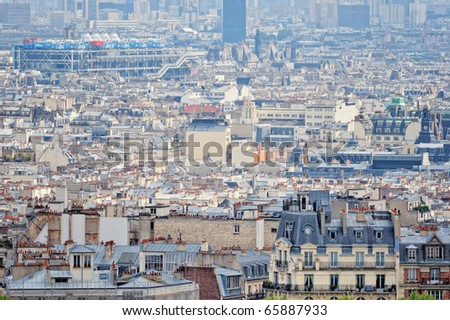 Aerial panorama above houses rooftops in a Paris