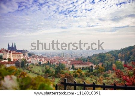 Aerial panorama from Strahovsky Cloisters (Strahov Monastery) over Prague including Prague castle and old town. Hazy views from Petrin Hill during autumn