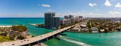 Aerial panorama Miami Beach Haulover Bal Harbour inlet bridge over water