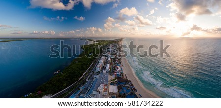 Shutterstock Aerial panorama of Hotel Row in Cancun, Mexico featuring the major hotels and resorts with white sandy beaches and blue ocean during a morning sunrise
