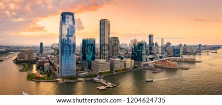 Aerial panorama of Jersey City skyline at sunset. Stock photo ©
