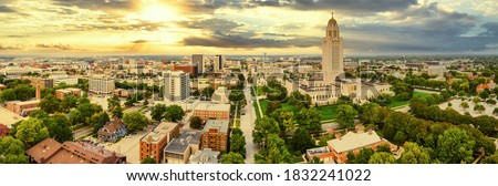 Aerial panorama of Lincoln, Nebraska under a dramatic sunset. Lincoln is the capital city of the U.S. state of Nebraska and the county seat of Lancaster County