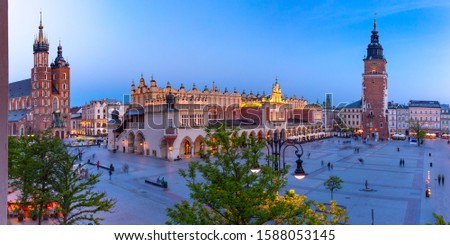 Aerial panorama of Medieval Main market square with Basilica of Saint Mary, Cloth Hall and Town Hall Tower in Old Town of Krakow at night, Poland Photo stock ©