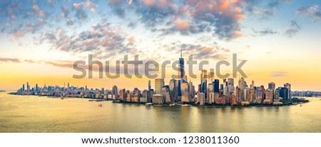 Aerial panorama of New York City skyline at sunset with both midtown and downtown Manhattan #1238011360