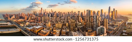 Aerial panorama of New York skyline above Hudson Yards midtown Manhattan skyscrapers on a sunny afternoon