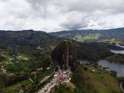 Aerial panorama of Piedra Del Penol El Penon de Guatape rock stone inselberg monolith granite dome hill mountain in Antioquia Colombia South America