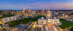Aerial panorama of Providence skyline and Rhode Island capitol building at dusk. Providence is the capital city of the U.S. state of Rhode Island. Founded in 1636 is one of the oldest cities in USA.
