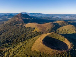 Aerial panorama of Puy Pariou and Puy de Dome volcanoes, Auvergne-Rhone-Alpes, France