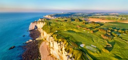 Aerial panorama of seaside with chalk cliffs at Etretat - Normandy, France