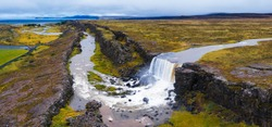 Aerial panorama of the Oxarafoss waterfalls in Iceland. Oxarafoss also called Oxararfoss is located in the Thingvellir National Park on the Oxara River.