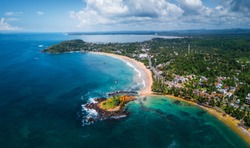 Aerial panorama of the tropical beach in the town of Mirissa, Sri Lanka