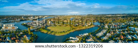 Aerial panorama of Varsity Lakes suburb, Reedy Creek and Lake Orr at sunset. Gold Coast, Queensland, Australia #1322319206