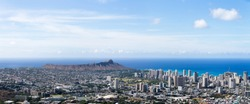 Aerial panorama of Waikiki, Diamond head and the University of Hawaii and coastline Oahu, Hawaii on a sunny blue sky day in a travel concept