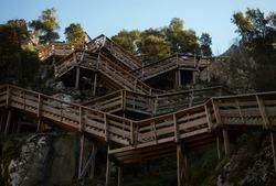 Aerial panorama of wooden walkway zigzag stairs staircase nature hiking trail path Passadicos do Paiva in Espiunca Areinho Arouca Aveiro Portugal Europe