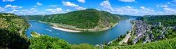 Aerial panorama 180 on Rhine loop (Rheinschleife) in Oberwesel am Rhein. Town on the Upper middle rhine river (Mittelrhein). Beautiful Postcard view, blue sky, clouds. Rhineland-Palatinate, Germany