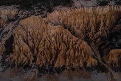 Aerial panorama view of Arriba Fossil da Praia da Gale Fontainhas beach hoodoo fairy chimney earth pyramid rock formations canyon erosion, atlantic ocean Melides Portugal Europe