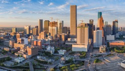 Aerial panorama view of downtown Houston, Texas as seen from the near northeast side.  New construction in this growing portion of the city is illuminated in early morning sunlight.