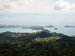Aerial panorama view of green islands in Kennedy Bay from Tokatea Lucas Lookout Hill mountain in Coromandel Peninsula Waikato New Zealand