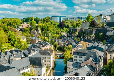 Aerial panorama view of Luxembourg-City with Grund, Alzette river, and modern buildings in the background Stock photo ©
