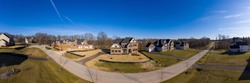 Aerial panorama view of new luxury real estate neighborhood street being built with large mansions and curb appeal