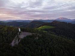 Aerial panorama view of white observation on cliff edge Urlingerwarte on Blassenstein mountain hill in Scheibbs Lower Austria alps Europe