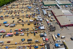 Aerial panorama view on flea market with miscellaneous items and crowds of buyers and sellers in Englishtown NJ US