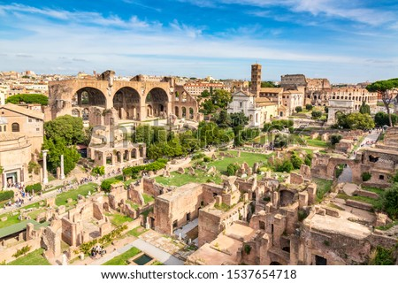 Aerial panoramic cityscape view of the Roman Forum and Roman Colosseum in Rome, Italy. World famous landmarks in Italy during summer sunny day. Stock photo ©