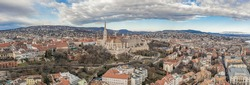 Aerial panoramic drone shot of Fisherman's Bastion on buda Hill in Budapest winter morning