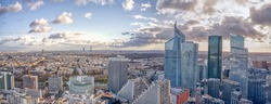 Aerial panoramic drone shot of La Defense of La Seine Side with skycraper in Paris before sunset