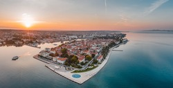 Aerial panoramic drone shot of Zadar old town sea organ in sunrise hour in Croatia Dalmatia area