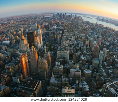 Aerial panoramic fish-eye view over lower Manhattan, New York from Empire State building top at sunset