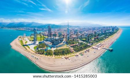 Aerial panoramic image of beautiful Batumi made with drone in sunny summer weather. Batumi is capital of Autonomous Republic of Adjara in Georgia, located on coast of Black Sea.